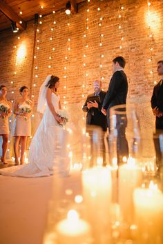 Glowing! #Backdrops | See more on SMP: http://www.stylemepretty.com/illinois-weddings/2013/11/12/goose-island-wedding-at-gallery-1028-from-tim-tab-studios | Photography: Tim Tab Studios