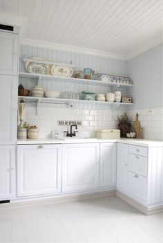 """I love the sign that says """"clean up after yourself"""" above the sink.  And I love the grooved timber on the walls - a lovely light and airy room."""
