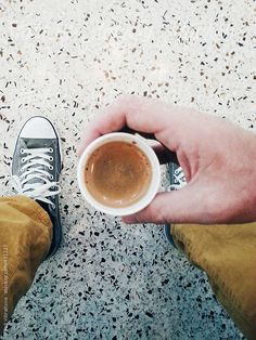 Having an Espresso to go by Good Vibrations Images for Stocksy United