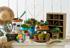 Clay pot planters - so cute for gifts or your patio garden Click thru for the full tutorials on how to make these projects! All are made with Handmade Charlotte Peel & Stick stencils available to buy in-store at major craft retailers #crafts #plaidcrafts #diy