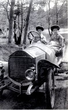 Sports Car, 1910s  This postcard shows two Hangyoku (Young Geisha) sitting in an early Automobile. The car is a Colibri (Hummingbird) manufactured by the Norddeutsche Automobil-Werke (North German Auto Works) between 1908 and 1912.