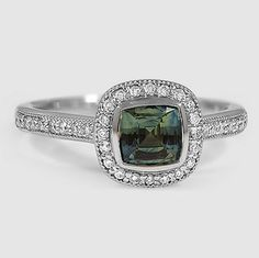An intricate halo diamond ring.
