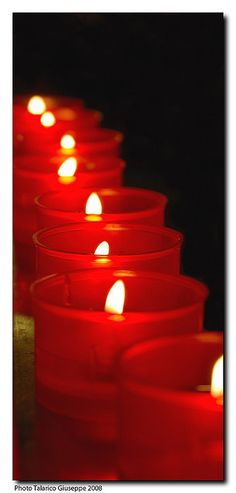 Red candles .Hope that comes form knowing that all the darkness in the world can not withstand the light of a single candle