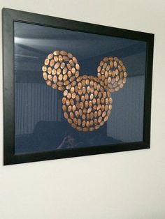 Mickey Mouse head out of pressed pennies from Disney.
