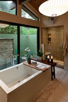 Contemporary Master Bathroom with Signature hardware chasse bamboo tub shelf, Pendant light, frameless showerdoor