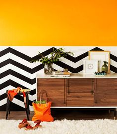 No ordinary wall..love the mix of bright color with the black and white pattern
