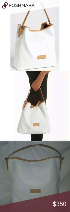 Lonchamp Derby White Hobo Leather Shoulder Tote 100% authentic - Large Canvas Tote. Style# 1812551007. This is an absolutely lovely structured bag! An easy-to-care-for coated-canvas bag is trimmed in a beautiful, natural cowhide leather for practical yet chic style. Used 4 times. Looks brand new, shows no signs of wear. . This tote is suppose to have a detachable zip pouch, but I lost it. Magnetic-snap closure.   Adjustable straps.   By Longchamp; Made in Tunisia  Adjustable double top…