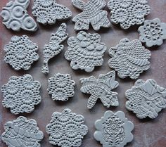 Clay Christmas decorations. So pretty! Press lace doilies into clay - add color or metallic on top surfaces?