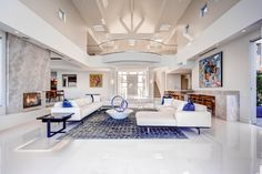 Contemporary Living Room with Carpet, High ceiling, metal fireplace, Balcony, limestone tile floors