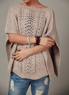Knitted Poncho in wheat.