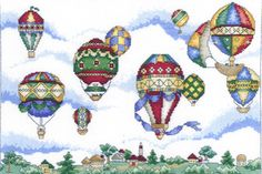 A lovely colourful picture of 19th century style hot air ballons sailing over a pretty landscape.