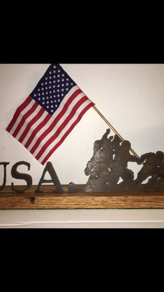 Iwo Jima memorial saw.  Set in an oak base with flag mounted to match saw silhouette position.