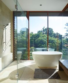 The bathroom has amazing views, that be enjoyed from both the shower and the bath.