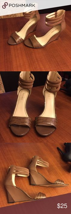 Nine West ankle strap wedge I absolutely love these shoes but they are just a little too small. Only been worn a couple times. Small scuff on very front of shoe (see pic). This style is so flattering and cute! Nine West Shoes Wedges