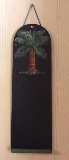 A ceiling fan blade, trim and chalkboard paint =a message board Created by Nelta B Mathias Studio
