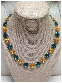 Swarovski Emerald Green and Sunflower large crystal spirit necklace.