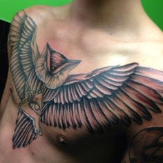 Mens Chest Tattoo With Owl Spreading His Wings