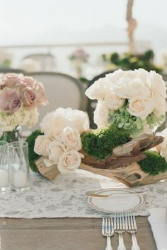 Driftwood, moss and roses centerpiece.