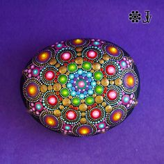 This Mandala stone is approximately 13 cm ( 5,1 inch) in diameter and 994 gr. This is a gorgeous Mandala Rock so vibrant, colorful and tactile! I find this stone on beach of the Ionic Sea in Italy. I hand painted this special stone with acrylic paint and brush and then protect it