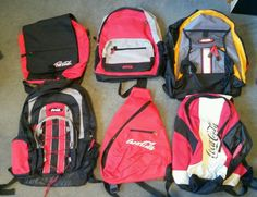 Assorted Coca Cola bags and backpacks