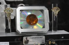 Alter Ego Comics is pleased to offer the #JamesBond #Goldeneye Prop Replica, from Pierce Brosnan's first outing as 007 in the 1995 film, Goldeneye.  Copied from the original movie props, the lens on this full size prop replica is made of aluminum and acrylic and features a concealed light up feature (requires 2 AAA batteries - not included).  The display also features two solid, machined metal keys with an electroplated gold finish.
