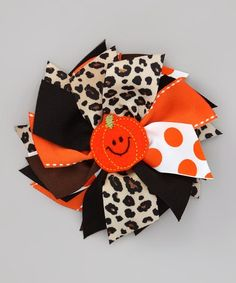 Take a look at this Black Pumpkin & Leopard Spikey Bow Clip by Zazzy Zebra on #zulily today!
