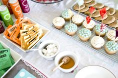 Baby shower spread: Izze sodas, tea, cookies and cupcakes. Cute