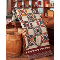 Fantastic Flying Geese in this Kennesaw Mountain quilt from Tributes and Treasures by Red Crinoline Quilts.