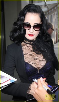 313c300371 Dita Von Teese Opens Up on Sexuality   Says She s Not a Lesbian  Photo Dita  Von Teese is glamorous in black while making an appearance on Huffington  Post ...