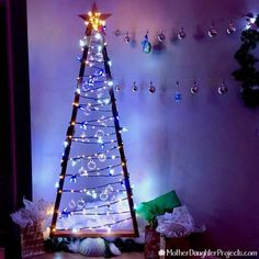 Learn how to use simple wood to make this modern and rustic Christmas tree for the holidays. Great for smart Christmas lights, fairy lights and more! All complete with a quikete concrete base. Wooden Xmas Trees, Christmas Tree Crafts, Handmade Christmas Decorations, Rustic Christmas, Simple Christmas, Holiday Decor, Wood Tree, Modern Christmas, Danish Christmas