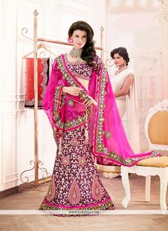 This delightful diva accoutre features unique styling and unusual material. Steal the hearts away with this hot pink fancy fabric and net a line lehenga choli. The ethnic embroidered and patch border ...