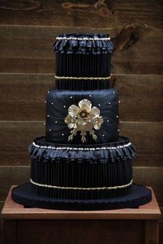 black and gold pleated wedding cake