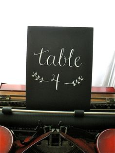 handwritten scripted table numbers