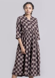 Hand printed cotton maxi dress tunnic and dress DS This dress is made of cotton to make you feel comfortable,unique color pallet in combination with geometric prints make it super stylish *hand block printed *cotton *maxi dress *calf length *3/4 sleeves *v-neck *gathered at waist