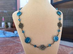 Beautiful brass and turquoise Czech glass necklace with Swarovski Crystal accents by RealBeadDesigns on Etsy