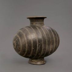A burnished pottery cocoon jar, Western Han Dynasty, 206BC-8AD, The dating consistent with Wollongong University TL certificate no W2502, 32cm high