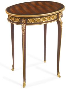 FRANÇOIS LINKE 1855 - 1946 A LOUIS XV STYLE GILT-BRONZE MOUNTED MAHOGANY, SYCAMORE, KINGWOOD AND SATINÉ TRELLIS PARQUETRY GUÉRIDON FRANCE, EARLY 20TH CENTURY fitted with one frieze drawer, one mount has been removed to reveal the FL mark and stamped LINKE to bottom front edge of frieze drawer height 28 1/2 in.; width 24 1/2 in.; depth 18 1/2 in. 72.5 cm; 62.5 cm; 70 cm
