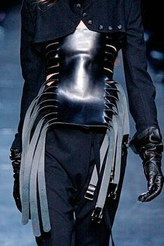 An interesting addition to a jacket - with various items hanging from the buckles.  Ann Demeulemeester