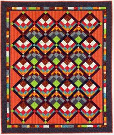 """Savannah Sunrise, 70"""" x 58"""" - designed and pieced by Maggie Ball, machine quilted by Wanda Rains, 32 Bargello blocks"""