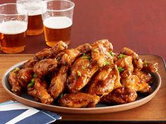 Chinese Barbecue (No. 31) : Roast the wings. Heat 1/2 cup minced scallions, 1/3 cup hoisin sauce, 2 tablespoons each butter, honey and grated ginger, and 3/4 teaspoon sesame oil. Toss with the wings.
