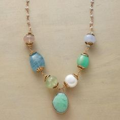 INFUSION NECKLACE--Jes MaHarry pairs chunky gems with a delicate chain infused with gray cultured pearls. Gems include chrysoprase, aquamarine, apatite and pink quartz. 14kt rose and yellow gold