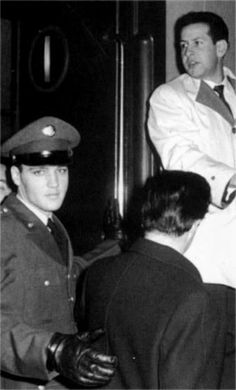 Elvis getting on the train with Joe Esposito and Charlie Hodge in 1960.