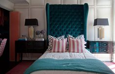 Giant aqua velvet headboard- leather studded wall!