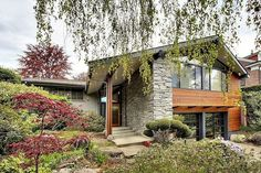 This stunning home remodel by Brandt Design and Dyna Contracting, is situated in the residential gated community of Broadmoor, in Seattle, Washington. Arch Architecture, Residential Architecture, Spa Design, House Design, Beautiful Buildings, Beautiful Homes, Halls, Cottage Exterior, My Dream Home