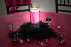 Black Feather Boa | Black feather boa centerpiece on hot pink satin linens