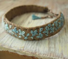 Teal Ombre Embroidered Bracelet    Measures: 8 1/4 inches long including clasp and chain x 1/4 inch wide.  will fit wrist size 6 3/4 to 7 3/4 inches.    Ombre design in shades of teal hand embroidered on brown linen with a copper colored lobster clasp.    I do my best to get the colors as true to life as possible but keep in mind the colors may vary from monitor to monitor.    You can find more of my bracelets here:  http://www.etsy.com/shop/Sidereal?section_id=7924083    or    Click here to…
