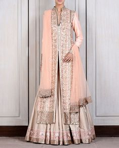 Buy Beige Raw Silk Lehenga with Blush Jacket by Manish Malhotra online in India at best price. Beige raw silk lehenga with kashmiri tilla borders teamed with a blush raw silk jaal embroidered jac Pakistani Dresses, Indian Dresses, Indian Outfits, Indian Clothes, Indian Skirt, Manish Malhotra Collection, Lehenga Collection, Raw Silk Lehenga, Lehenga Choli