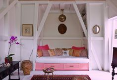 Pink daybed w/ exposed architecture as frame; M. Design Interiors