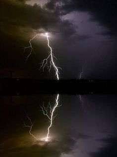 Razor-like lightning with an equally sharp reflection, photographed during a…                                                                                                                                                                                 More