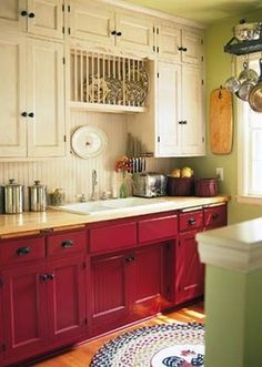 Two Tone Painted Cabinets... nice..like the red on the bottom, also the bead board back splash and black hard wear.